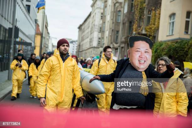 A protester wearing the mask of Kim Jongun attends a demonstration and human chain between US and North Korean embassies organized from awarded Nobel...