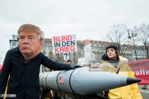 A protester wearing the mask of US President Donald Trump attends a demonstration and human chain between US and North Korean embassies organized...