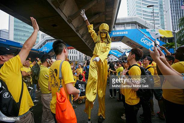 A protester wears a clown costume near the Merdeka Square during a Bersih rally as protestors call for the resignation of Prime Minister Najib Razak...