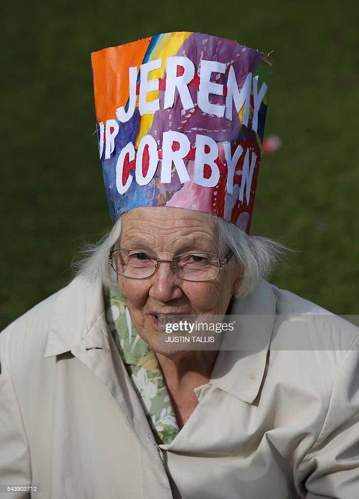 A Protester wears a hat with a message written in support of Leader of the opposition Labour Party Jeremy Corbyn outside parliament during a pro-Corbyn demonstration in central London on June 27, 2016. Britain's historic decision to leave the 28-nation bloc has sent shockwaves through the political and economic fabric of the nation. It has also fuelled fears of a break-up of the United Kingdom with Scotland eyeing a new independence poll, and created turmoil in the opposition Labour party where leader Jeremy Corbyn is battling an all-out revolt. TALLIS