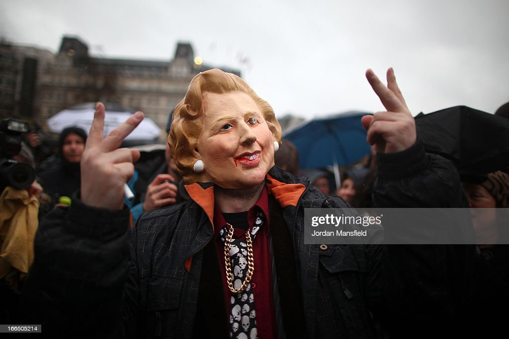 A protester wears a Margaret Thatcher mask during a party held in Trafalgar Square following the death of the former British Prime Minister Margaret Thatcher on April 13, 2013 in London, England. Downing Street announced that the funeral of former Prime Minister Baroness Thatcher will take place at London's St Paul's Cathedral on April 17.