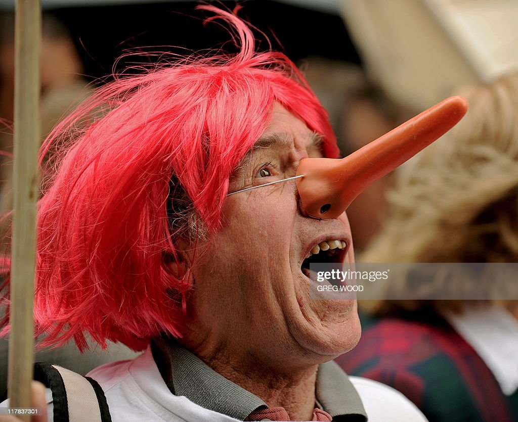 A protester wears a 'Pinocchio' style nose and a red wig during a rally in Sydney on July 1 2011 against redheaded Australian Prime Minister Julia...