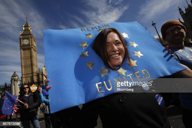 A protester wears a 'Remain United' European Union flag sign on her head during a Unite for Europe march to protest Brexit in central London UK on...