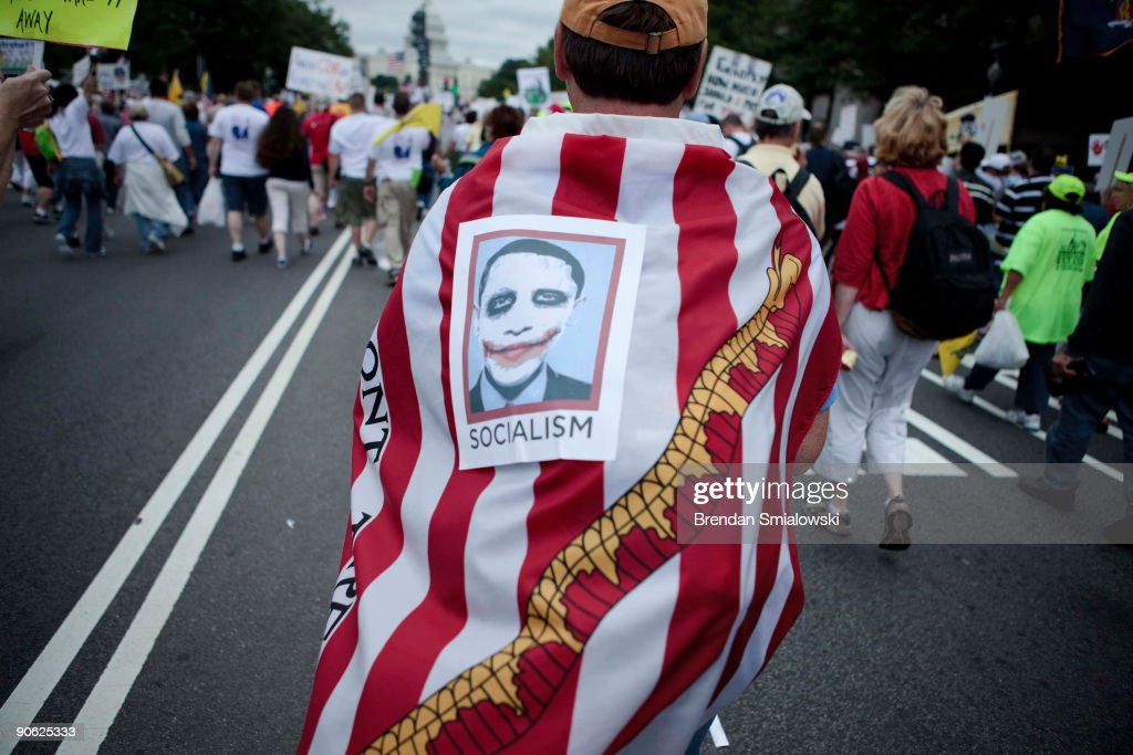 A protester wears an American Revolution era flag and an Obama picture during the Tea Party Express rally on September 12 2009 in Washington DC...