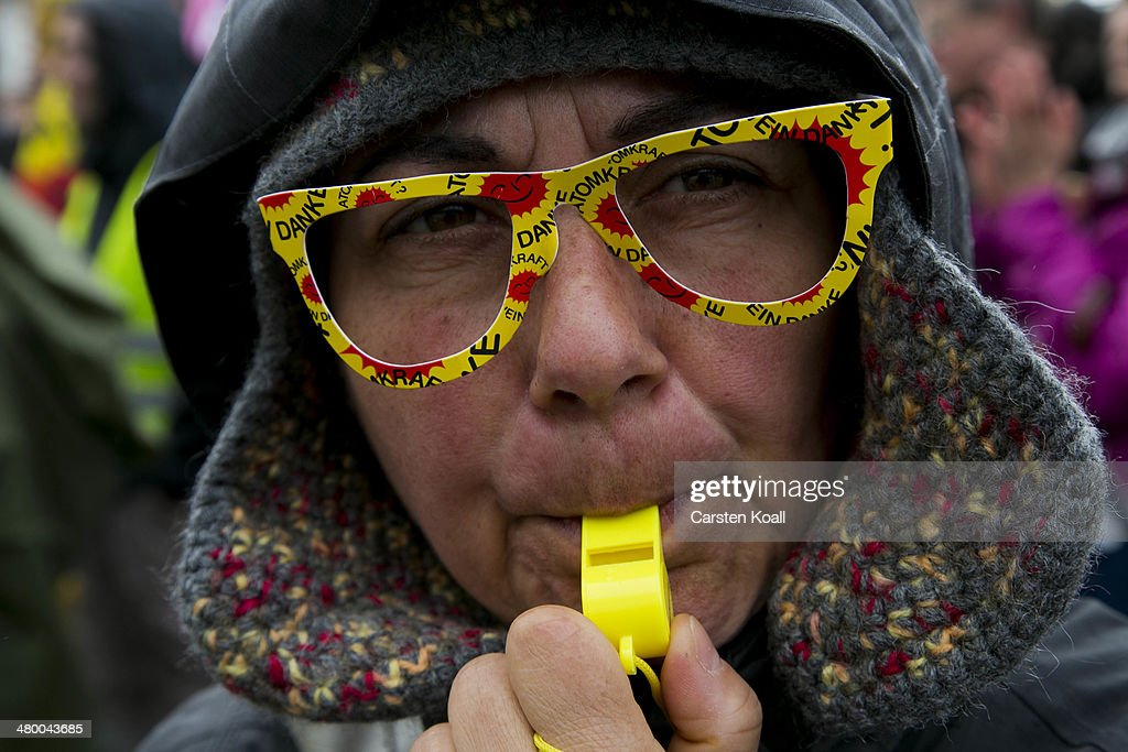 A protester wears glasses with the symbols of the anti-nuclear movement while demonstrators march to demand a faster transition to renewable energy sources on March 22, 2014 in Postdam, Germany. Similar protests are being held across Germany today as Germany's drive toward covering a higher portion of its energy demands with renewables has faltered recently due to high costs and an incomplete infrastructure.
