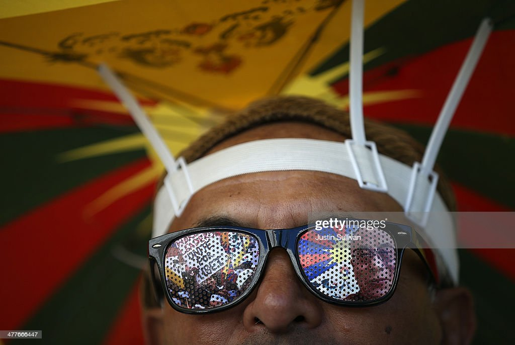 A protester wears sunglasses with the image of Tibetan spiritual leader His Holiness the Dalai Lama during a demonstration outside of the Chinese consulate on March 10, 2014 in San Francisco, California. Hundreds of activists marked the 55th anniversary of the 1959 Tibetan uprising and the fifth anniversary of Tibetan self-immolation protests in Tibet.