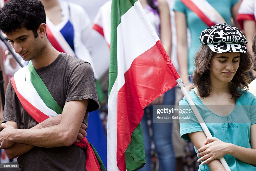 Protester wears the Iranian flag while standing with other activists during a rally July 11, 2009 in Washington, DC. Activists gathered to rally for the current uprising in Iran over the recent elections.