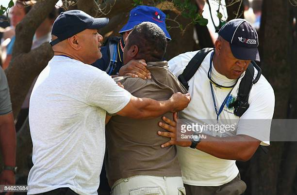 A protester who attempted to assault New Zealand Prime Minister John Key is taken by Police from TeTii Marae on February 5 2009 in Waitangi New...