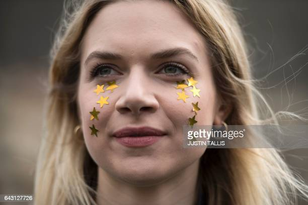 A protester with 12 gold stars representing the European flag stars as tears on her cheeks takes part in a 'Flag Mob' in Parliament Square in central...