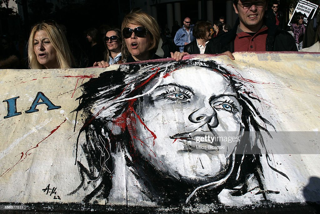 A protester with a banner marches during an anti-austerity protest on November 14, 2012 in Athens, Greece. Unions in Spain, Portugal and Greece went on strike in what has become the first broad-based anti-austerity action to protest government plans amid a wide economic scope across Europe.