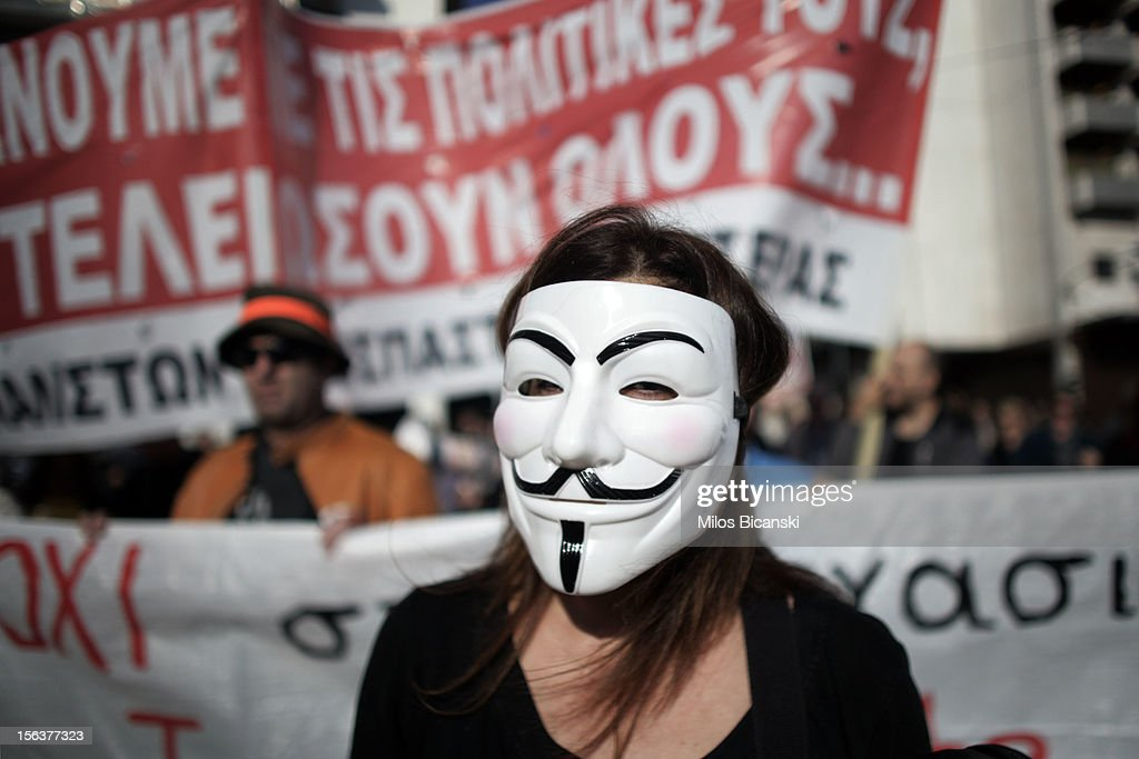 A protester with a mask marches during an anti-austerity protest on November 14, 2012 in Athens, Greece. Unions in Spain, Portugal and Greece went on strike in what has become the first broad-based anti-austerity action to protest government plans amid a wide economic scope across Europe.