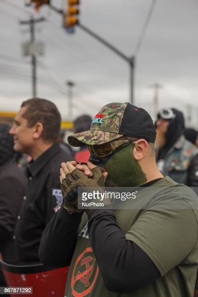 A protester with camo face paint warmed himself in the brisk morning air in Shelbyville Tennessee Illinois US on 28 Ocotber 2017