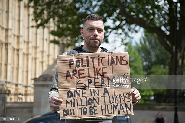 Protester with his placard at College Green in Westminster outside the Houses of Parliamant following a Leave vote also known as Brexit as the EU...
