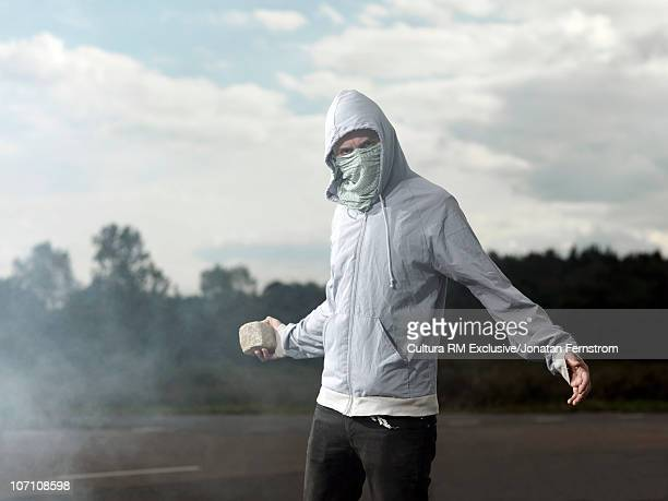 Protester with paving-stone