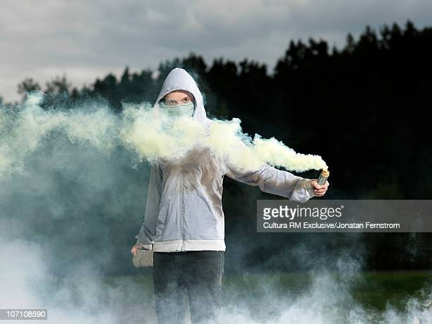Protester with smoke grenade