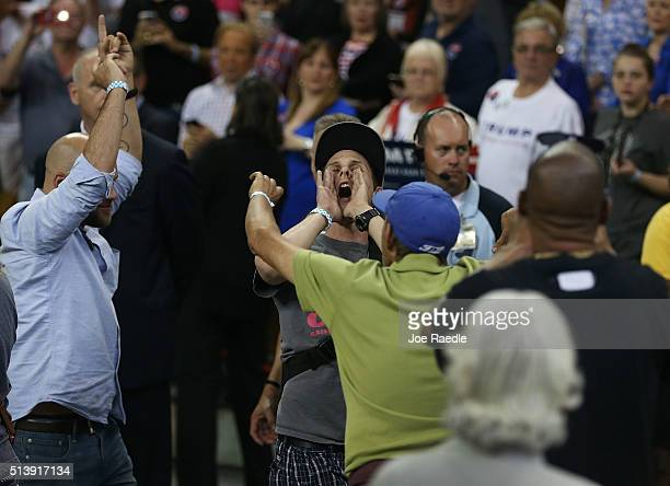 A protester yells as he is escorted out of a campaign rally for Republican presidential candidate Donald Trump at the CFE Arena during a campaign...