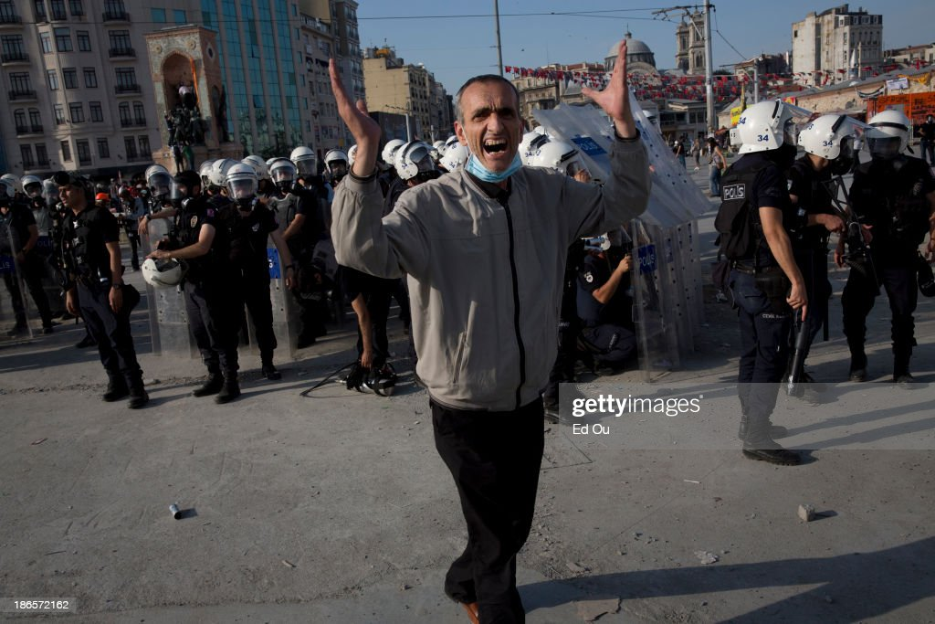 A protester yells as police fire teargas at protesters in Takism Square in Istanbul Turkey on June 11 2013 Hundreds of police entered Taksim Square...