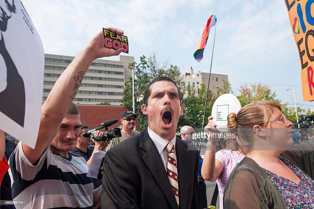 A protester yells out against same-sex marriage supporters in front of the federal courthouse September 3, 2015 in Ashland, Kentucky. Kim Davis, the Rowan County Clerk of Courts, is expected to appear at a contempt of court hearing at the courthouse today. Citing a sincere religious objection, Davis, who is an Apostolic Christian, has refused to issue marriage licenses to same-sex couples in defiance of a Supreme Court ruling.