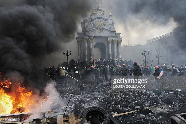 Protesters advance towards new positions in Kiev on February 20 2014 Armed protesters stormed police barricades in Kiev on Thursday in renewed...