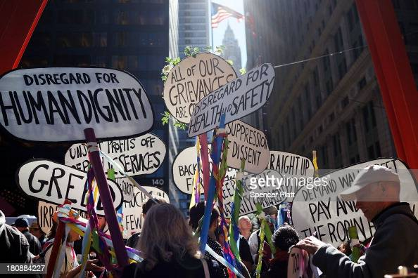 Protesters affiliated with Occupy Wall Street demonstrate for a variety of causes at Zuccotti Park near the New York Stock Exchange on the second...