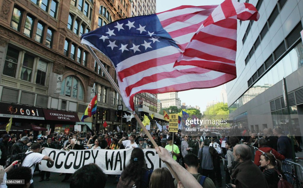 Protesters affiliated with Occupy Wall Street march down Broadway in Manhattan towards Wall Street on May 1, 2012 in New York City. Occupy Wall Street has joined with unions during the May Day protests, a traditional day of global protests in sympathy with unions and leftist politics.