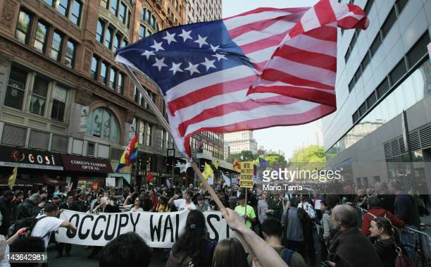 Protesters affiliated with Occupy Wall Street march down Broadway in Manhattan towards Wall Street on May 1 2012 in New York City Occupy Wall Street...