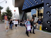 Protesters affiliated with the Occupy Las Vegas movement march past a Prada store at Crystals at CityCenter on the Las Vegas Strip October 6 2011 in...