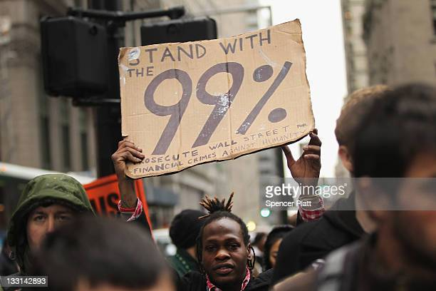 Protesters affiliated with the Occupy Wall Street Movement march up Broadway to attend a rally in Union Square on November 17 2011 in New York City...