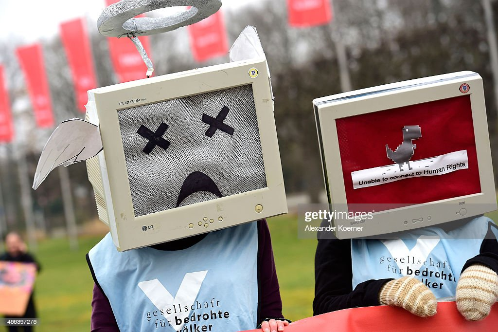 Protesters against internet censorship wearing Computers as helmets are seen outside Hanover Congress Centrum on March 15 2015 in Hanover Germany...