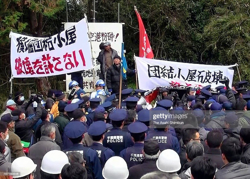 Protesters against Narita Airport face off with police officers as a local court ordered to remove the hut occupied by anti-airport protesters near Narita International Airport on November 28, 2012 in Shibayama, Chiba, Japan. The anti-airport group formed against the opening of the airport and its expropriation process back in 1960s.