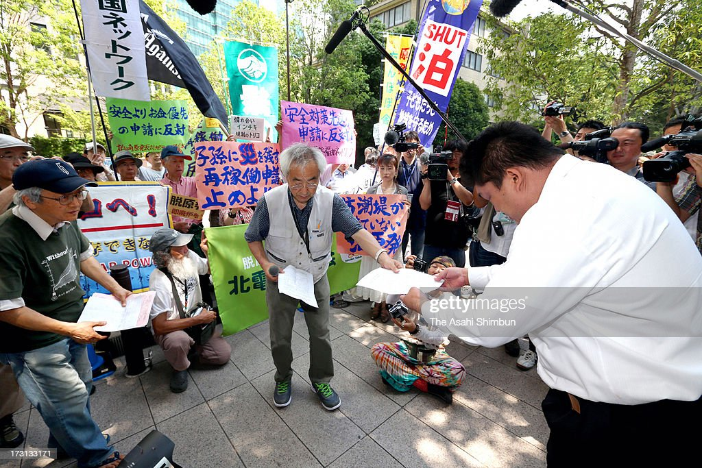 Protesters against nuclear plants restart gather in front of the building where the Nuclear Regulation Authority is located on July 8, 2013 in Tokyo, Japan. Four utilities of Hokkaido, Kansai, Shikoku and Kyushu apply for the safety examinations of ten reactors of five nuclear power plants, on the day tougher standards took effect to prevent a recurrence of the 2011 Fukushima nuclear crisis.