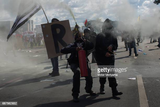 Protesters against President Michel Temer clash with the police on May 24 2017 in Brasilia Brazil Demonstrators called for the resignation of Temer...