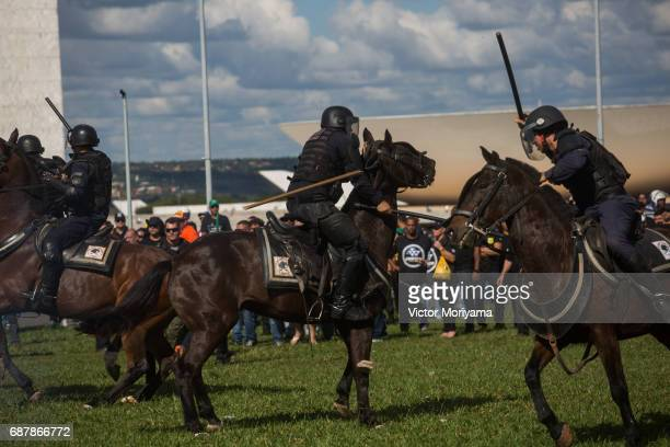 Protesters against President Michel Temer clashed with mounted police during a protest for direct elections in Planalto on May 24 2017 in Brasilia...