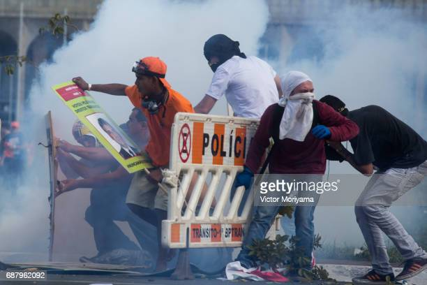 Protesters against President Michel Temer clashed with the police on May 24 2017 in Brasilia Brazil Demonstrators called for the resignation of Temer...