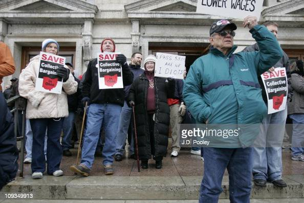 Protesters against Senate Bill 5 display their signs during a rally against a pending budget bill at the Ohio Statehouse February 22 2011 in Columbus...