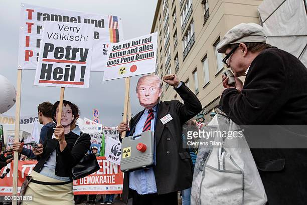 Protesters against the TTIP and CETA free trade agreements with masks play Frauke Petry cohead of the Alternative fuer Deutschland and US Republican...