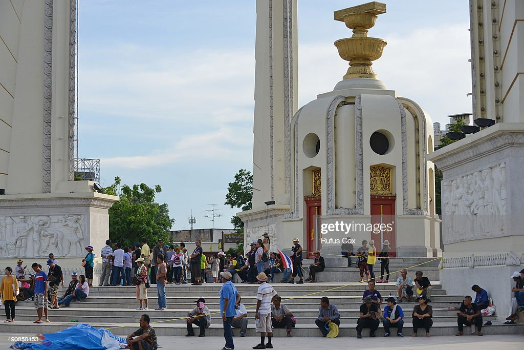 Protesters and bystanders gather at the scene of a deadly driveby attack on an antigovernment rally site at the landmark Democracy Monument on May 15...