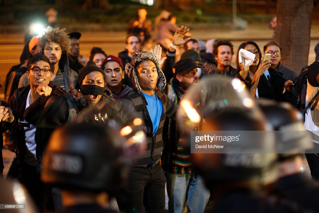 Protesters and police clash in front of LAPD Headquarters as people react to the grand jury decision not to indict a white police officer who had...