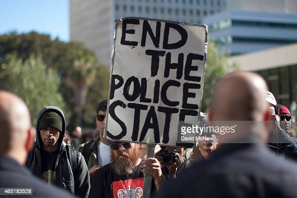 Protesters and police face off during a rally at Los Angeles Police Department Headquarters against the fatal police shooting of an unarmed homeless...