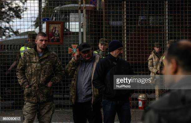 Protesters and policemen stand separated with a fence in Kyiv Ukraine Oct22 2017 Dozens Ukrainians set up a tent camp in front of Parliament after a...