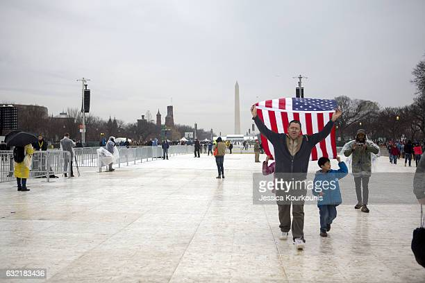 Protesters and supporters gather on the National Mall for the inauguration of Donald Trump on January 20 2017 in Washington DC Today Trump is sworn...