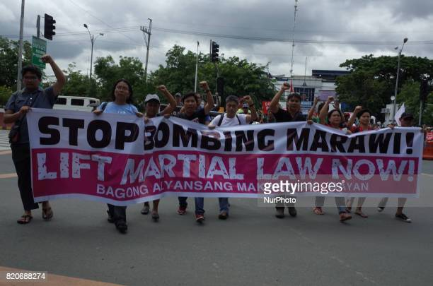 Protesters approach the gates of Philippine Congress as they hold a rally coinciding the joint session on Martial Law extension outside the House of...