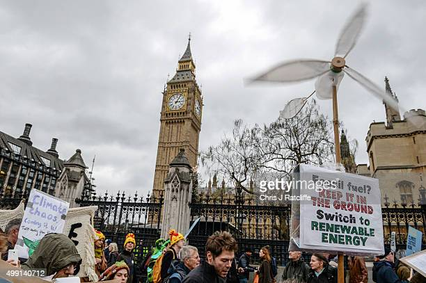 Protesters approach the Houses of Parliament during the London Climate March as part of march events around the globe on the same day on November 29...