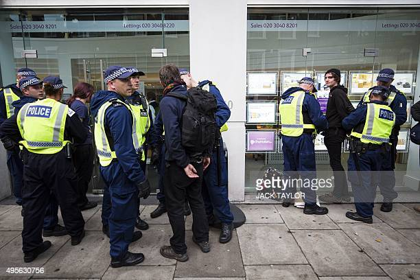 Protesters are arrested outside an estate agents during a demonstration against student fees in central London on November 4 2015 Students marched...