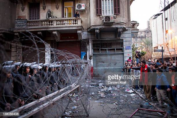 Protesters are blocked by police on their way to the interior ministry after a demonstration outside Cairo's Al Ahly football stadium on February 2...