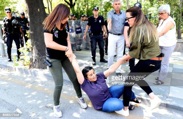 TOPSHOT Protesters are detained by riot police as they protest against the detention of hungerstriking teacher Semih Ozakca and literature professor...