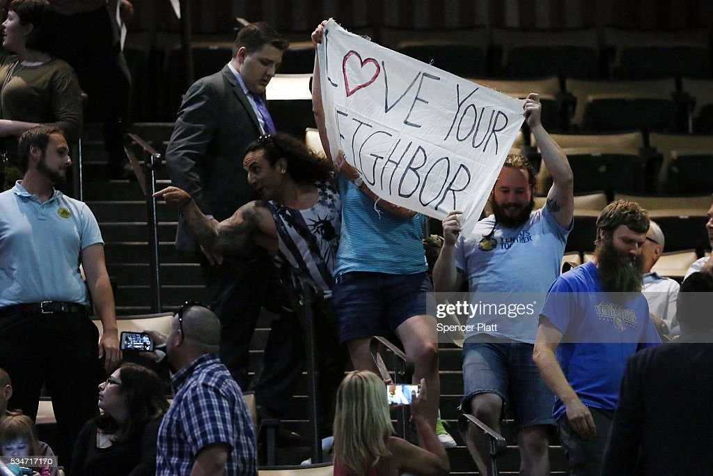 Protesters are escorted out as the presumptive Republican presidential candidate <a gi-track='captionPersonalityLinkClicked' href=/galleries/search?phrase=Donald+Trump+-+Born+1946&family=editorial&specificpeople=118600 ng-click='$event.stopPropagation()'>Donald Trump</a> speaks at a rally in Fresno on May 27, 2016 in Fresno, California. Trump is on a Western campaign trip which saw stops in North Dakota and Montana yesterday and two more in California today.