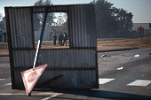 Protesters are framed through an improvised barricade blockading an intersaction during a service delivery protest on July 22 2016 ahead of August...