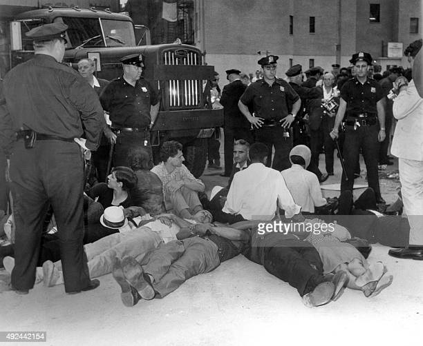 Protesters are lying at the entrance of the building site of a medical center on April 23 1964 in New York to protest against the discrimation in...