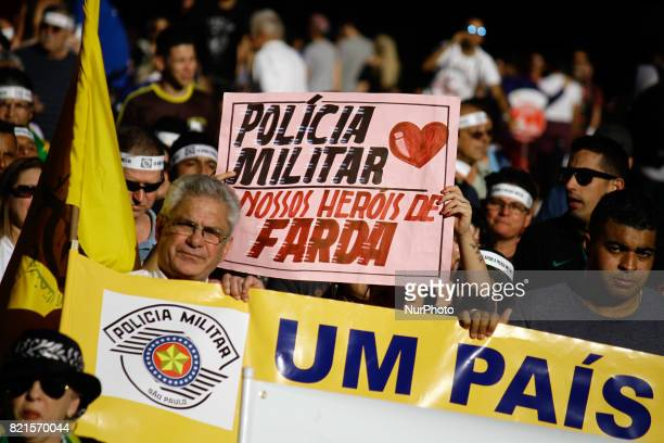 Protesters are participating in an act in support of the military police organized by the Right Movement São Paulo on Avenida Paulista central region...